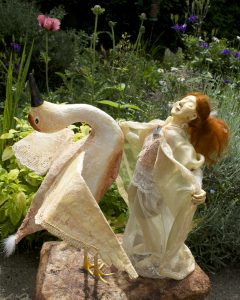Sculpture of bird and female figure dancing in a garden, ME/CFS Artist and Writer Corina Duyn