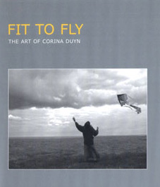 Reviews of Fit to fly documentary by David Begley about aritst Corina Duyn. image of corina flying a kite on Ardmore cliff