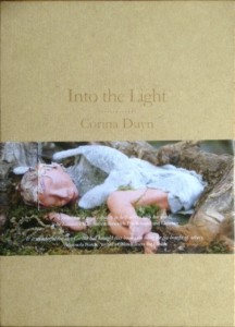 cover of Into the Light by Corina Duyn, A book in a wooden box. Corina Duyn's book shop
