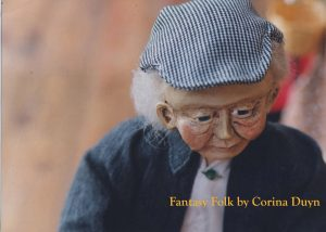Reviews Fantast Folk Artist doll by Corina Duyn. Image is of Old man in blue jacket and cap