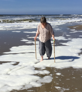 a walk in the sea, with walking sticks