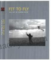 cover of Fit to Fly a documentary by David Begley References Artist and Writer Corina Duyn. Grey cover with photo of Corina Duyn flying a kite on Ardmore cliff